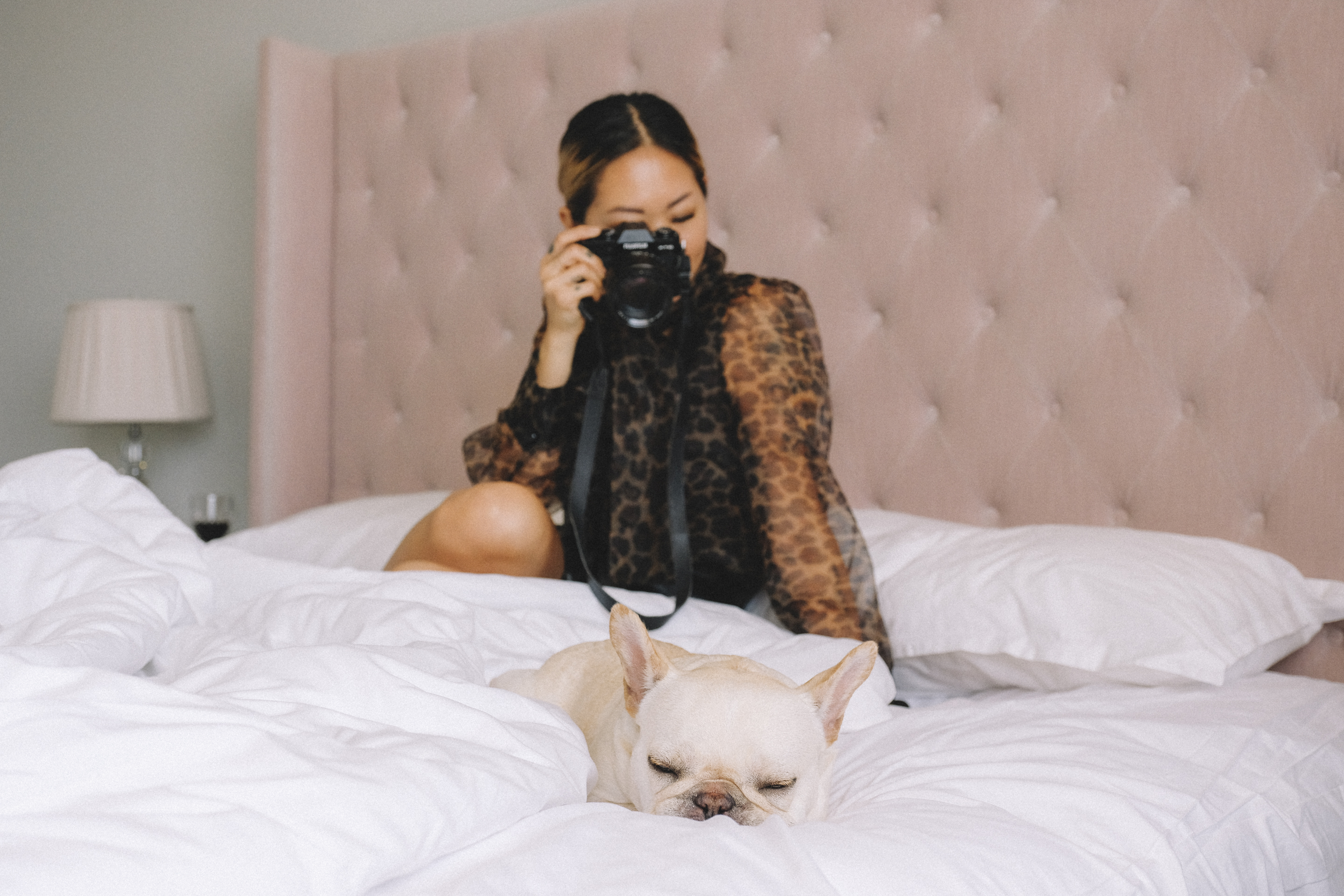 dog and girl in bed